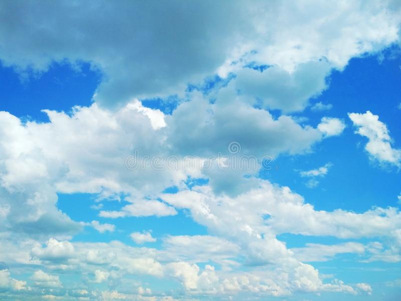 Cumulus clouds peacefully floating in the sky. View of a natural background, wool pack clouds that are peacefully floating in the sky stock photo