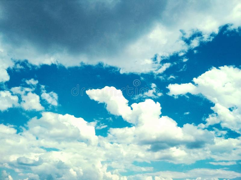 Cumulus clouds peacefully floating in the sky. View of a natural background, wool pack clouds that are peacefully floating in the sky stock photos