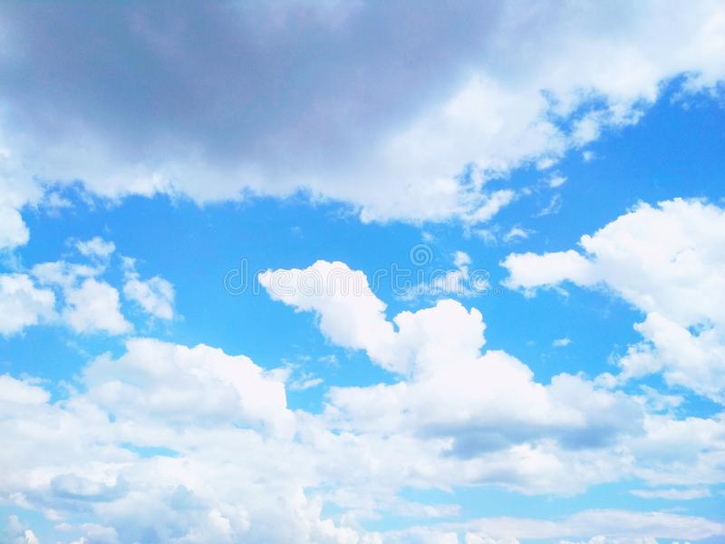 Cumulus clouds peacefully floating in the sky. View of a natural background, wool pack clouds that are peacefully floating in the sky royalty free stock photos