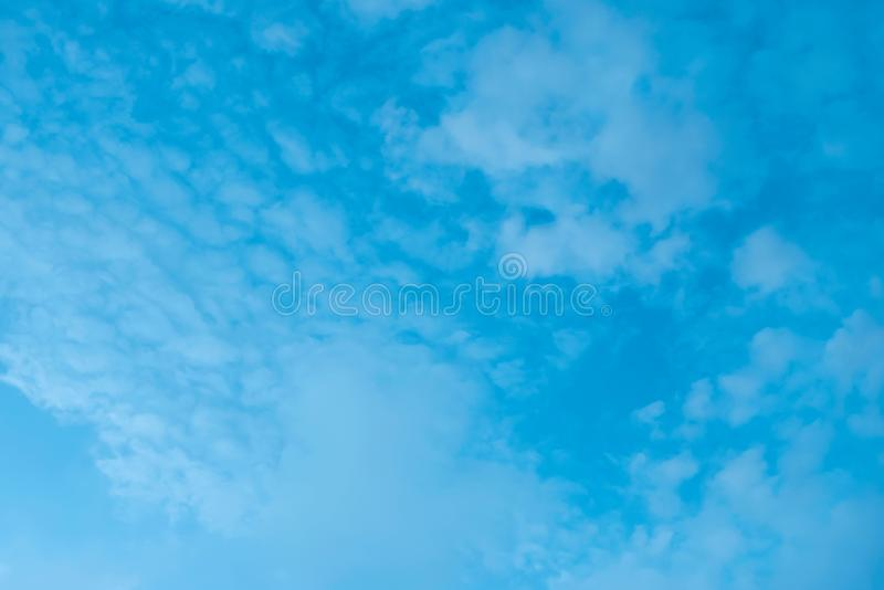 Cumulus clouds of the sunset with the sunset Blue sky blurred background defocusing. Cumulus clouds of the sunset with the sunset. Blue sky blurred background stock photos