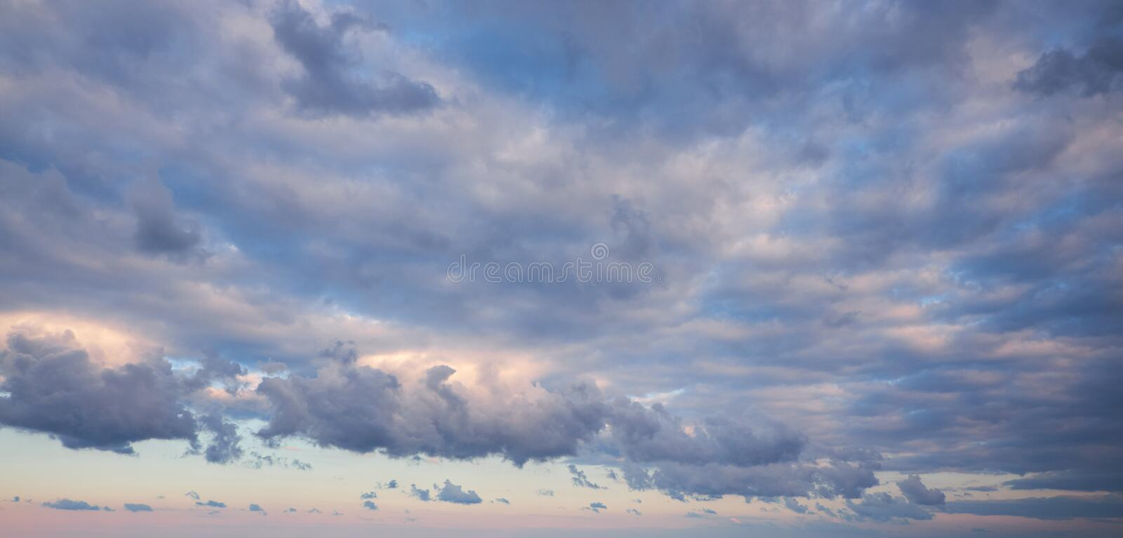 Cumulus and mottled clouds. Pure nature background royalty free stock photo