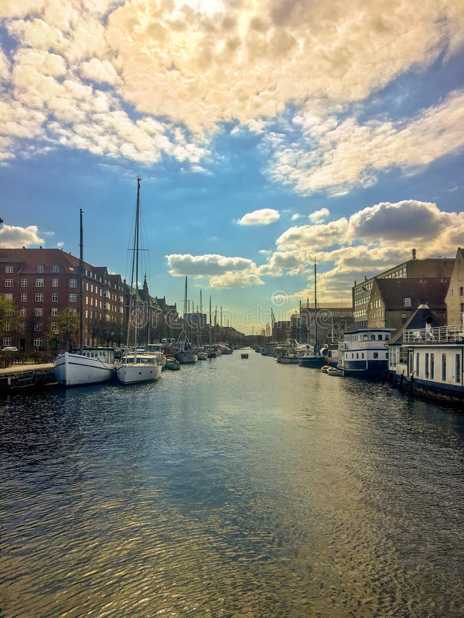 Cumulus in the sky over the city. Reflection of clouds in a water channel. Copenhagen. stock images