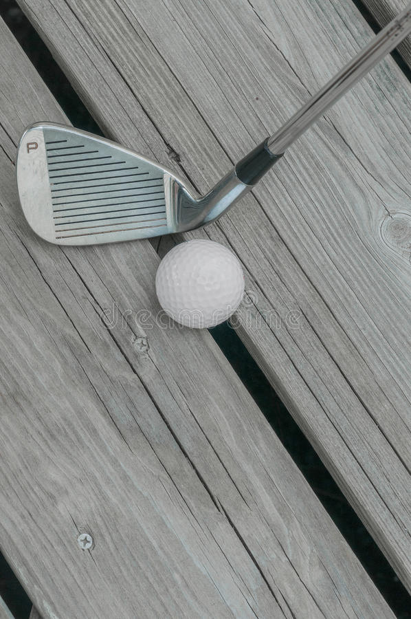 Cunha e bola de golfe de lançamento fotos de stock