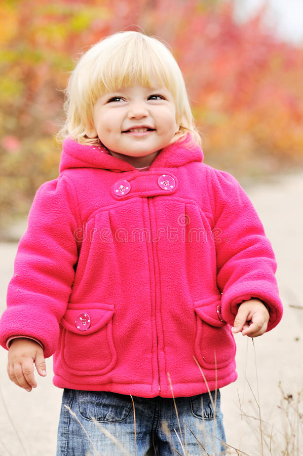 Cunning girl. Cunning baby girl with dimple cheeks stock image