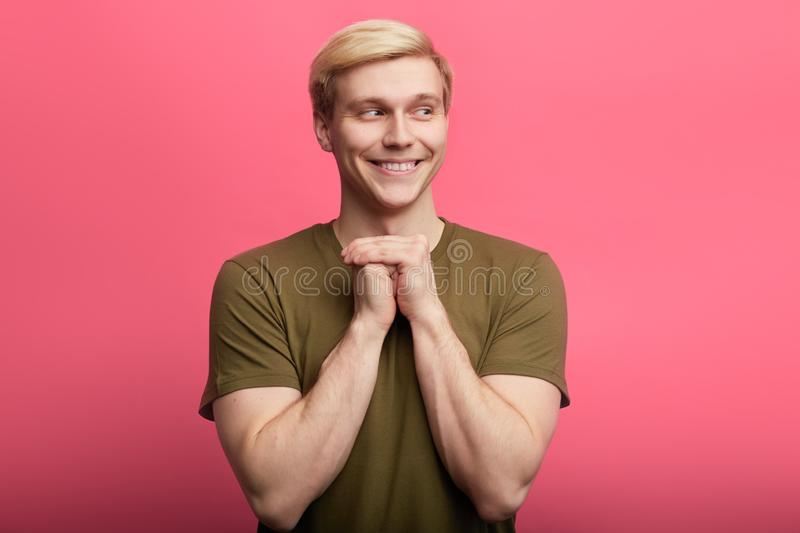 Cunning tricky smiling man standing with hand together stock image
