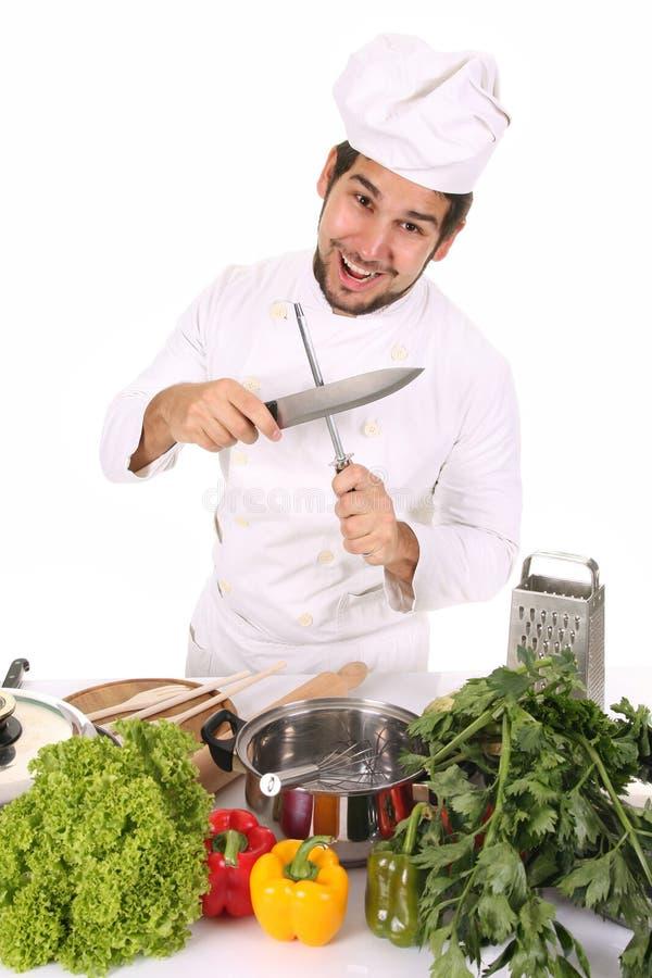 Cuoco unico che affila una lama immagine stock libera da diritti