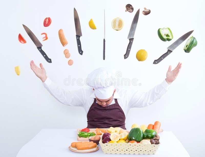 Cuoco unico che cucina con il concetto magico immagine stock