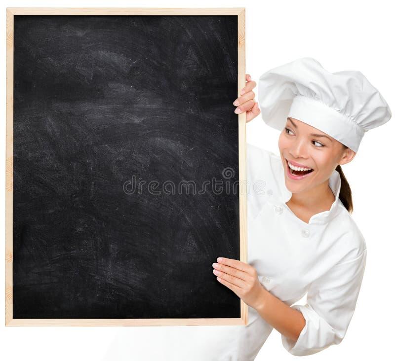 Cuoco unico che mostra il segno in bianco del menu immagini stock
