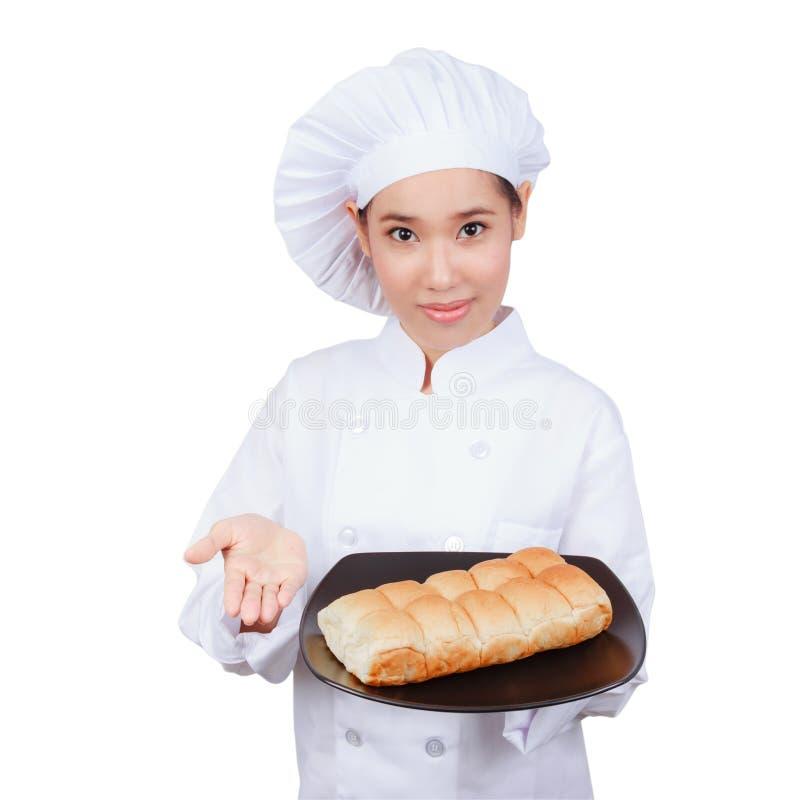 Cuoco unico che mostra piatto. fotografie stock