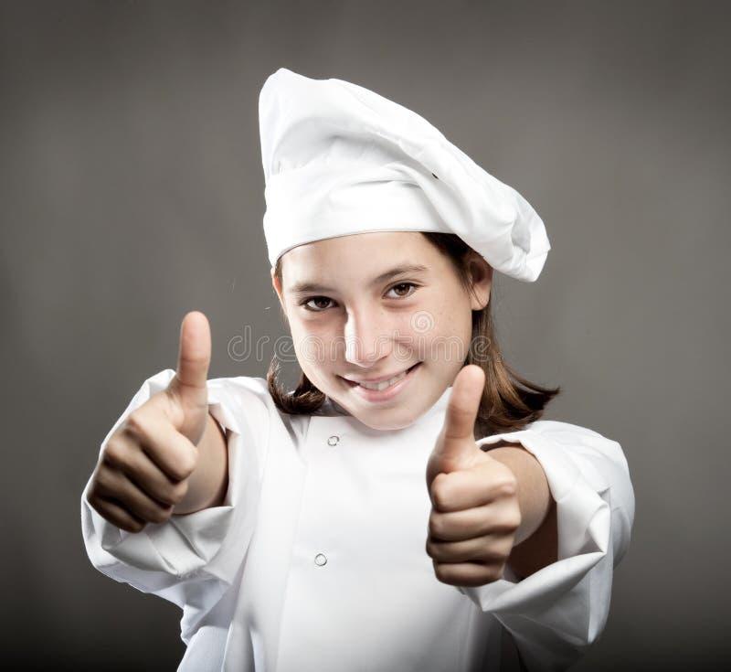 Cuoco unico con i pollici in su fotografia stock
