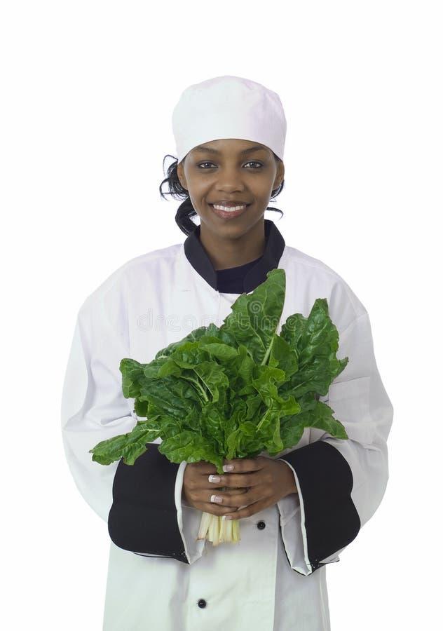 Cuoco unico e spinaci fotografie stock libere da diritti