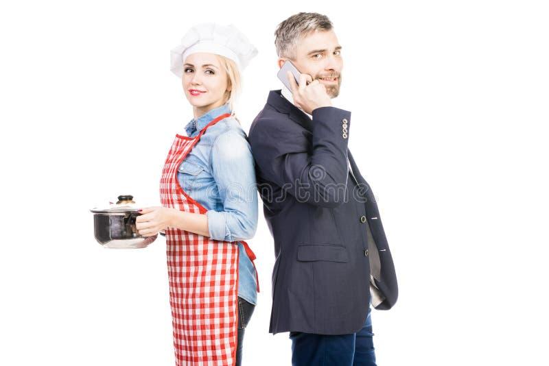 Cuoco unico ed uomo d'affari femminili immagine stock libera da diritti