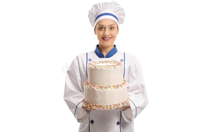 Cuoco unico femminile che tiene un dolce immagini stock