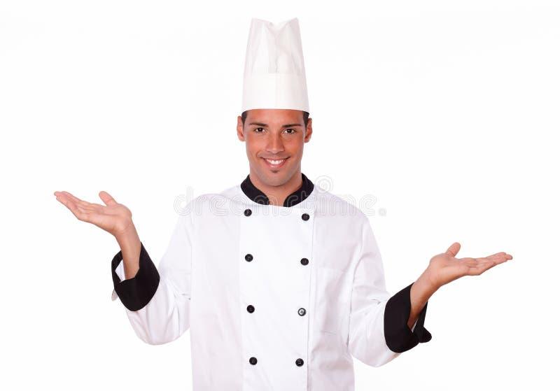 Cuoco unico ispanico bello che ostacola le sue mani fotografie stock