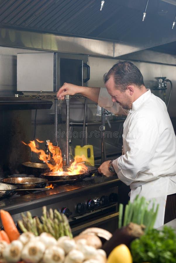 Cuoco unico lavorante fotografie stock