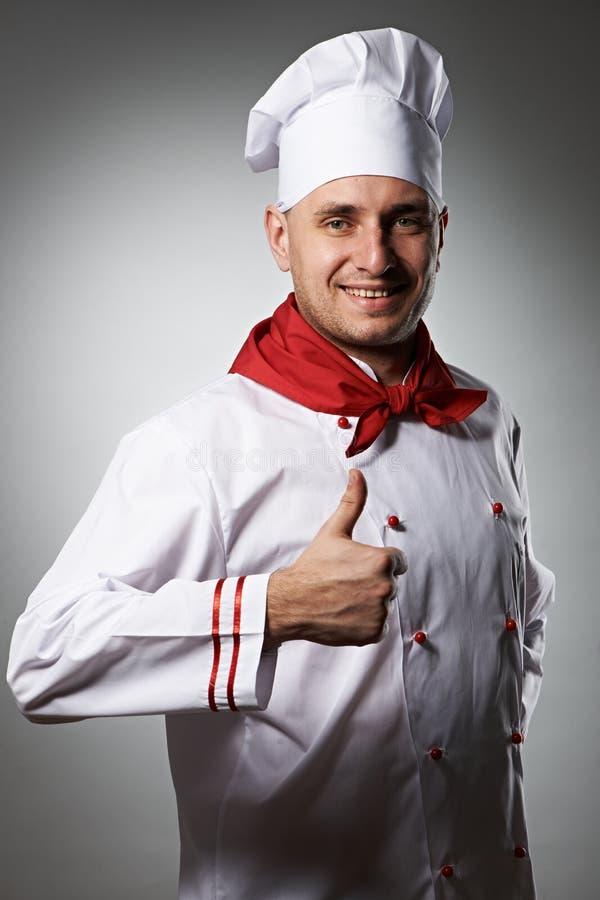 Cuoco unico maschio con il pollice sul ritratto immagine stock libera da diritti