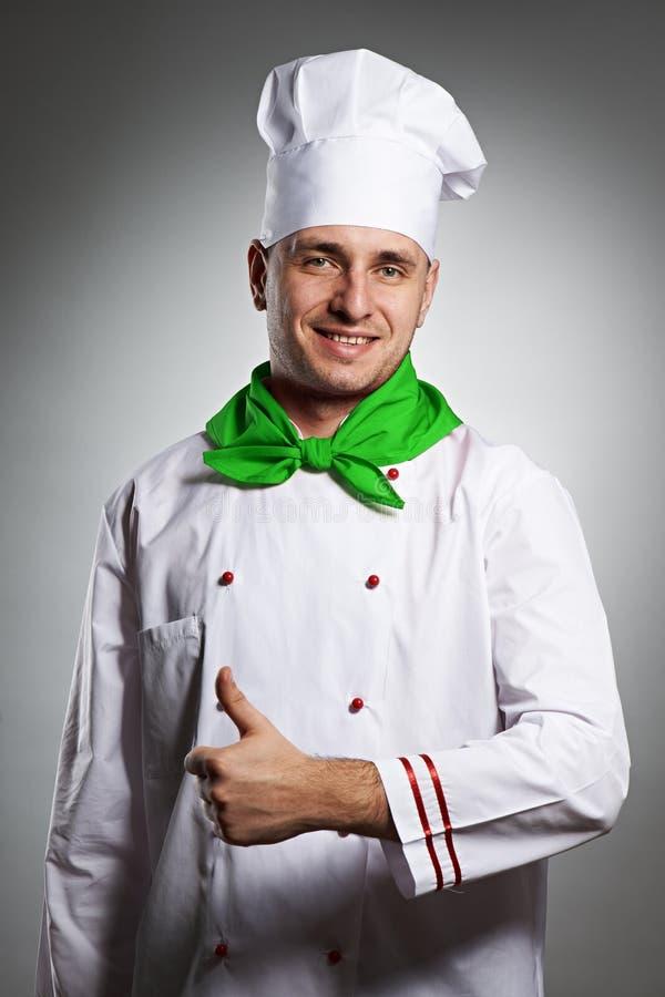 Cuoco unico maschio con il pollice sul ritratto immagini stock