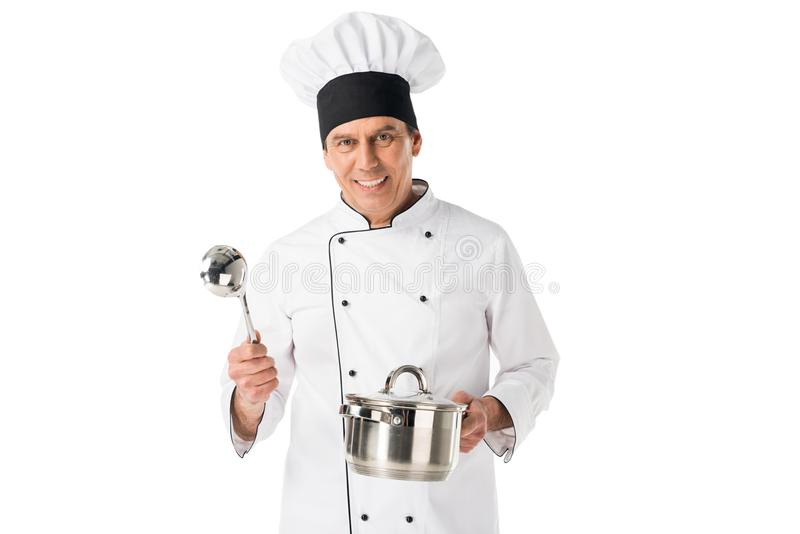 Cuoco unico in pentola e siviera della tenuta del blanche del toque e dell'uniforme fotografia stock libera da diritti
