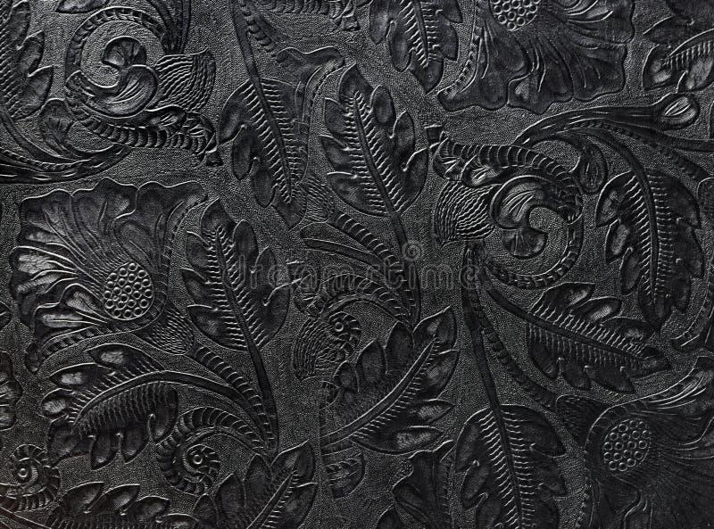 Cuoio nero brillante impresso con i motivi floreali fotografia stock libera da diritti