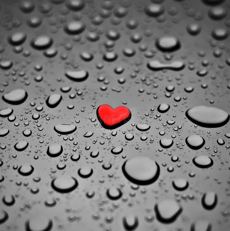 Cuore come goccia della pioggia fotografia stock