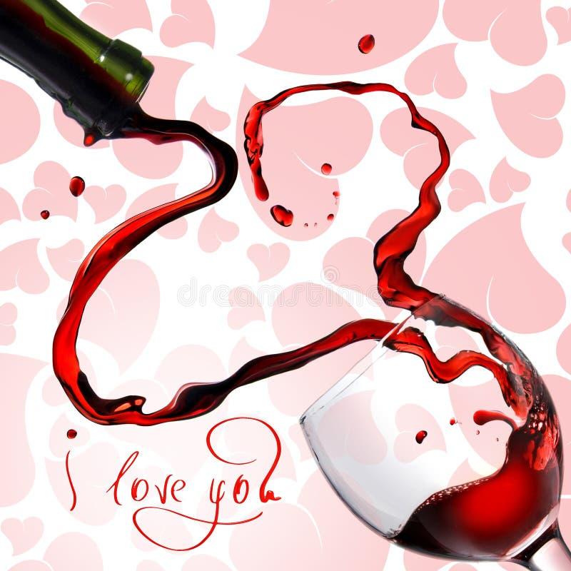 Cuore dal versamento del vino rosso in calice immagini stock