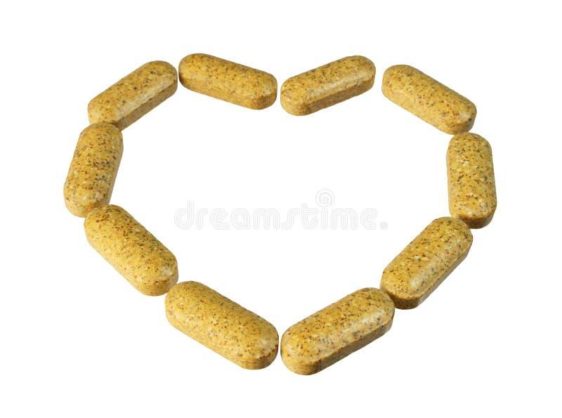 Cuore della pillola della vitamina fotografia stock libera da diritti