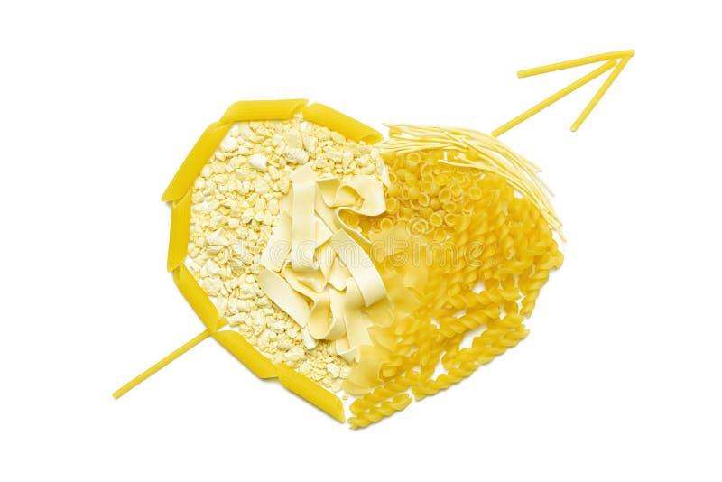 Cuore di pasta penetrante da una freccia immagini stock