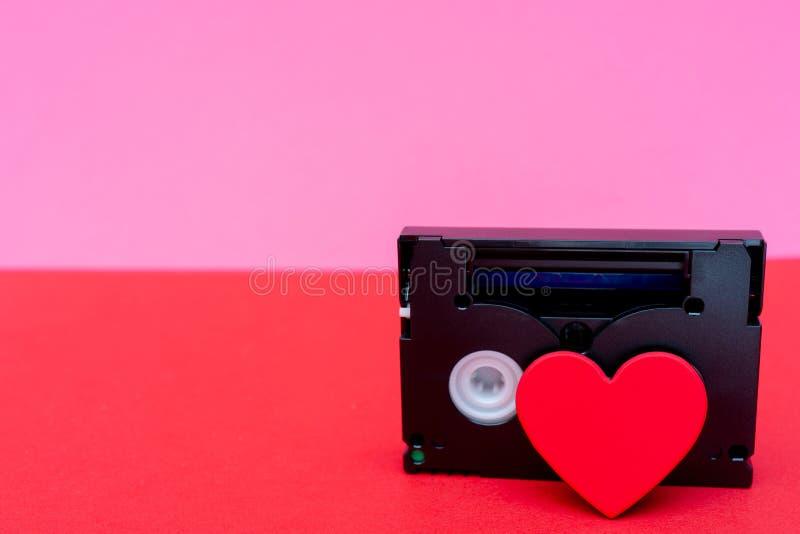 Cuore e videocassetta - cartolina di San Valentino fotografia stock