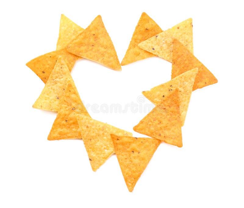 Cuore fatto dei chip di cereale su fondo bianco fotografie stock libere da diritti
