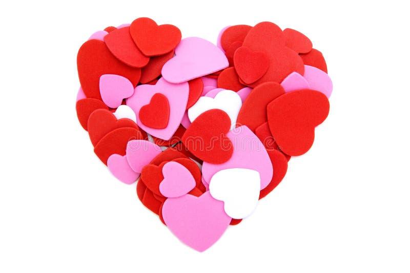 Cuore fatto dei coriandoli dei biglietti di S. Valentino fotografie stock
