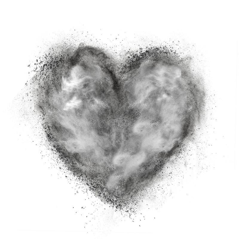 Cuore fatto dell'esplosione della polvere nera isolata su bianco fotografie stock