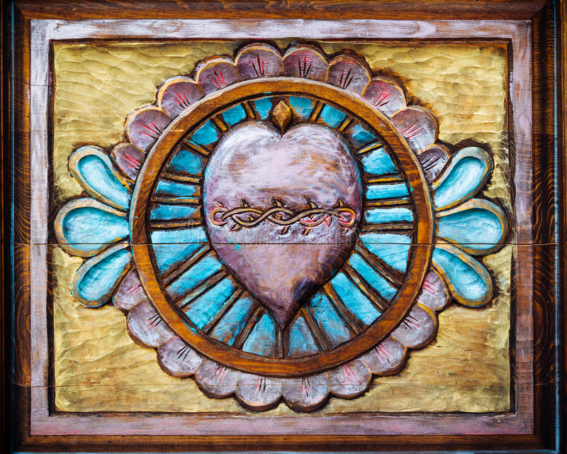 Cuore sacro scolpito su legno fotografie stock libere da diritti