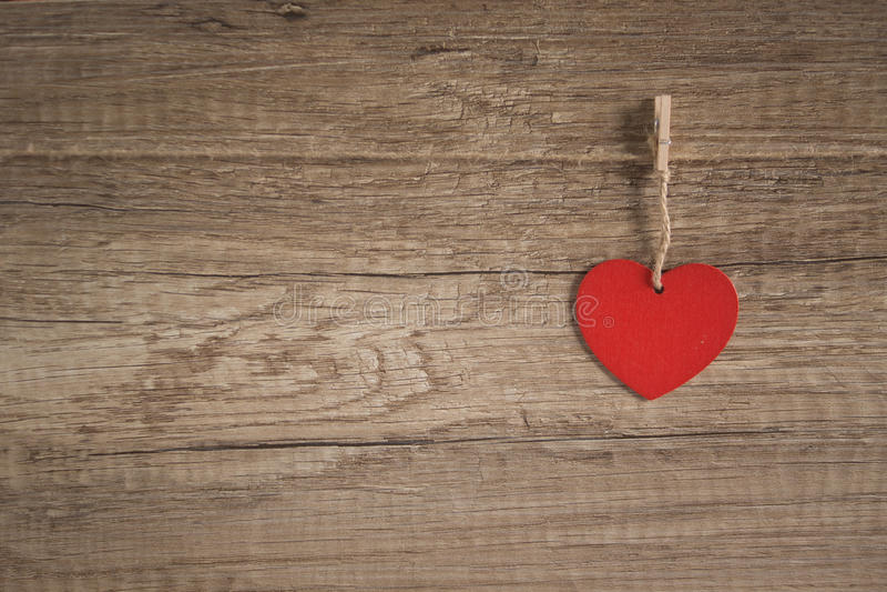 Cuore su priorità bassa di legno immagine stock