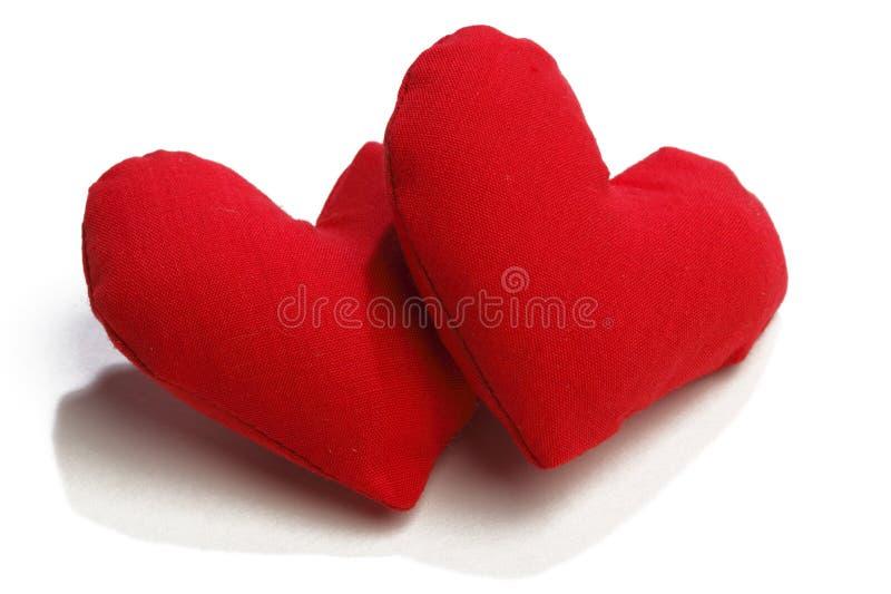 Cuori del tessuto di giorno di biglietti di S. Valentino fotografie stock