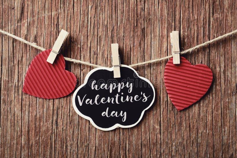 Cuori e giorno di biglietti di S. Valentino felice del testo immagine stock