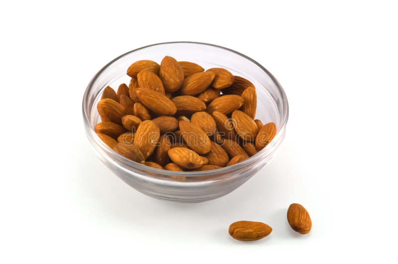 Cup with almonds stock photography