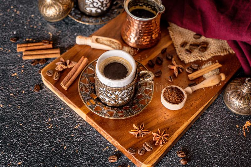 Cup of aromatic coffee drink and coffee beans on wooden background. Top view royalty free stock image