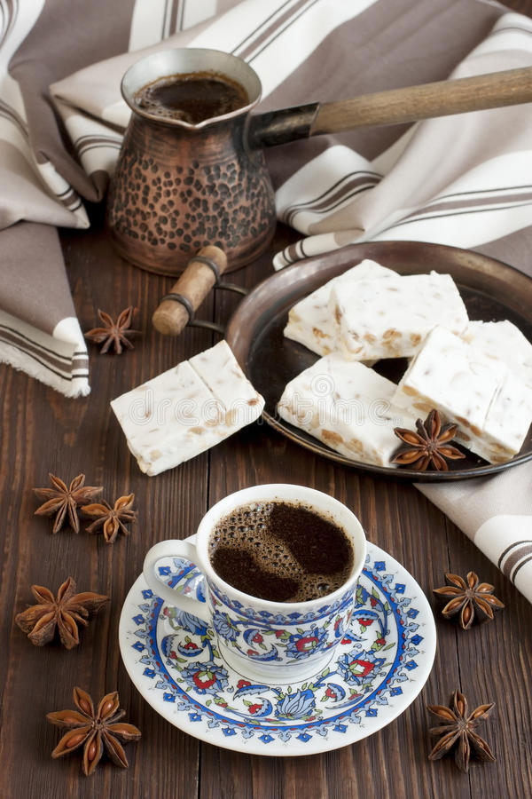 Cup of aromatic coffee with sweets royalty free stock photos