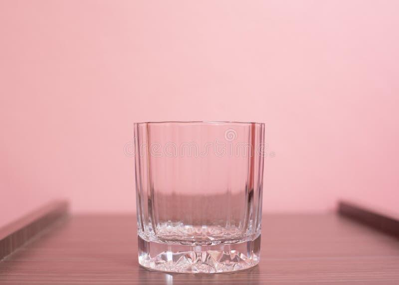 Cup auf rosa pastellfarbenem Hintergrund lizenzfreies stockfoto