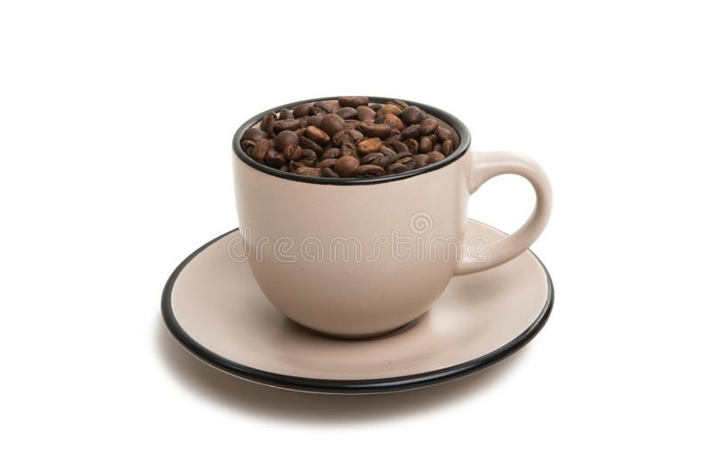 Cup with beans coffee. On white background royalty free stock photos