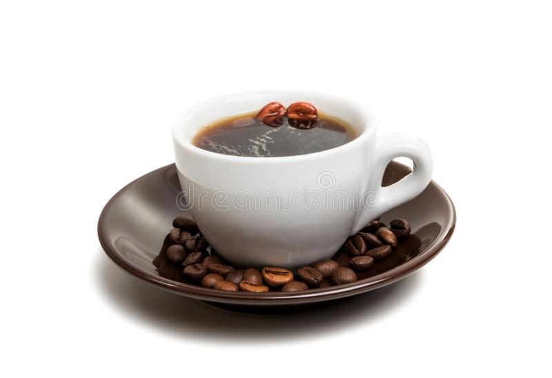 Cup with beans coffee. On white background stock photography