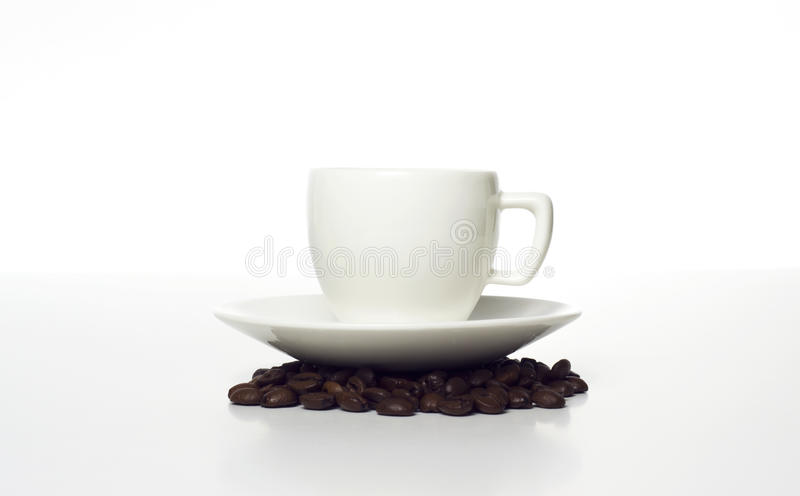 Cup On Beans Royalty Free Stock Photography