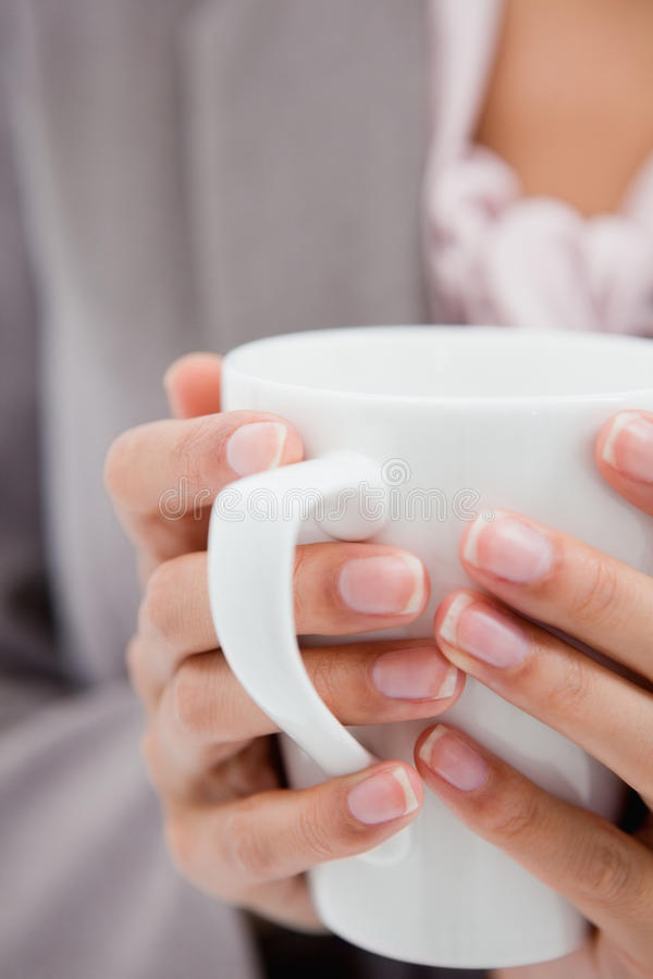 Cup Being Held By Female Hands Royalty Free Stock Images