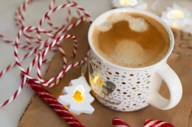 Cup of coffee and christmas decoration closeup stock images