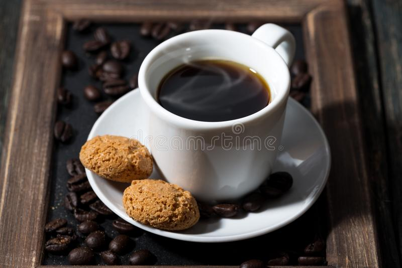 Cup of black coffee and cookies on a tray, closeup stock photos