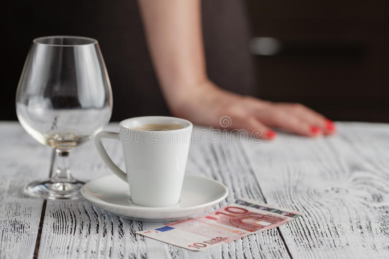 Cup of black coffee and euro banknotes royalty free stock photos