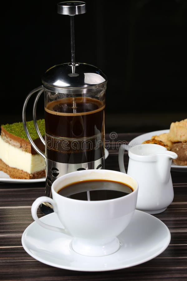 Cup of black coffee and french press. French press coffee maker on white background with stock photo