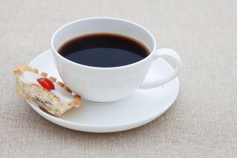 Download Cup Of Black Coffee With Half A Small Cake Stock Photo - Image: 13370826
