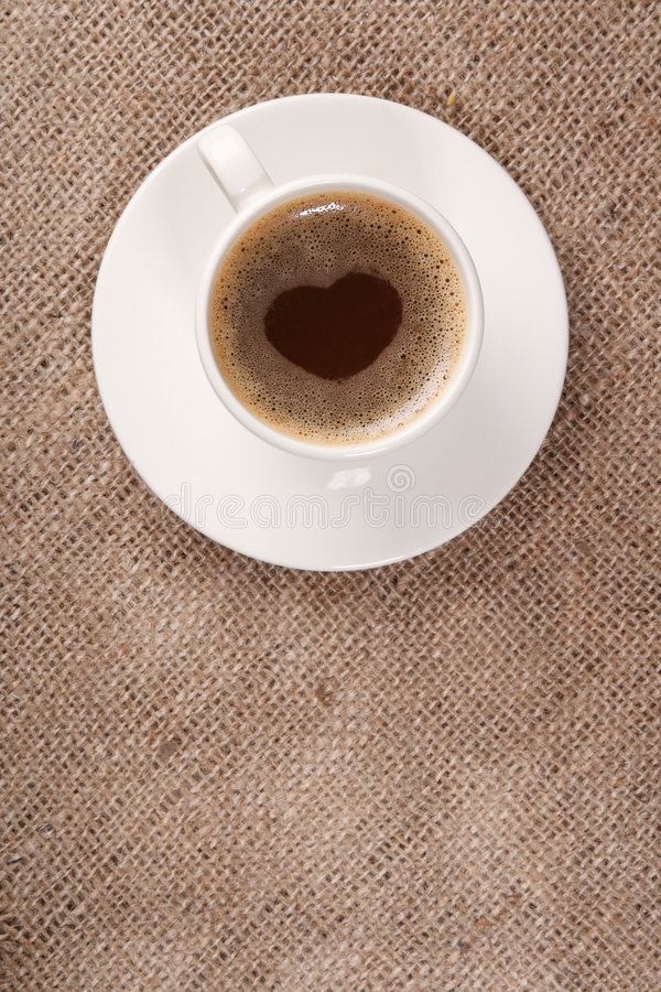 Cup of black coffee on hessian background stock photo