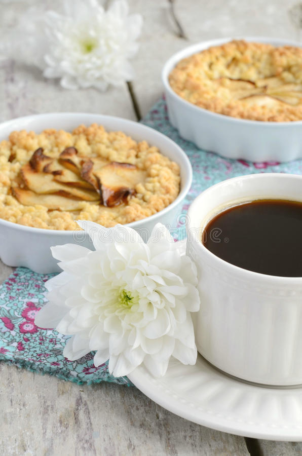 Cup of black coffee and homemade apple tart. Breakfast with cup of black coffee, homemade apple tart and white flowers stock photography